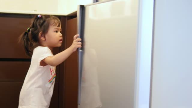 4K : Baby Girls Open Refrigerator video