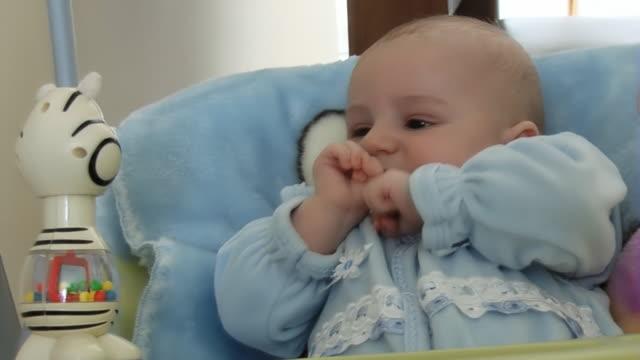 Baby goes on the swings medium shot sideways glance stock videos & royalty-free footage