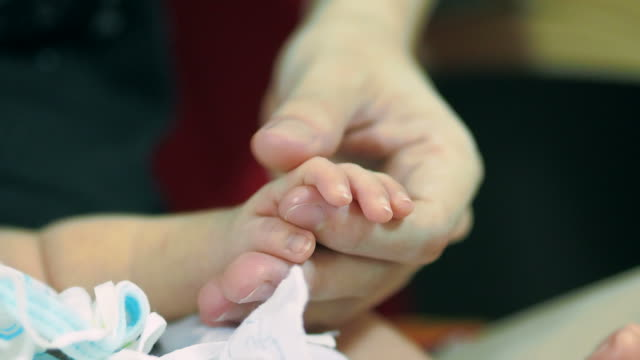 baby holding mother finger - frugal lifestyle stock videos and b-roll footage
