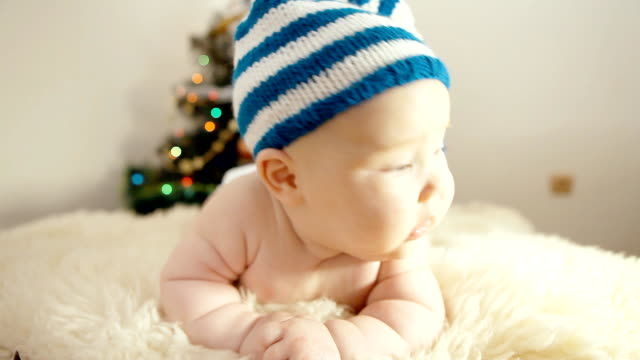 Baby in Christmas hat on the new year background video