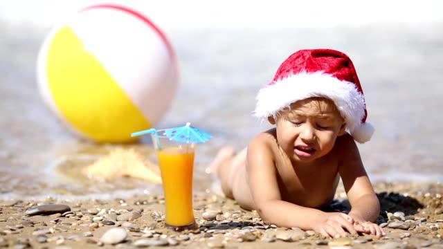 baby in Santa Claus hat restin