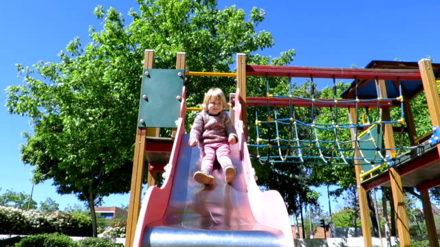 baby in slide in playground park video