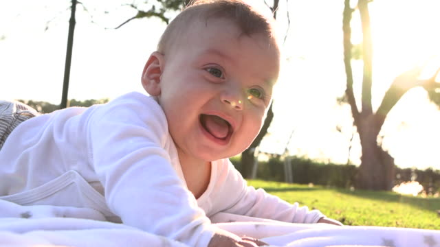 baby infant boy happy face expression outdoors smiling and feeling joy - 0 11 mesi video stock e b–roll