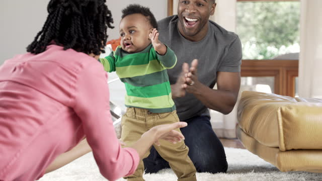 Baby learning to walk  medium shot stock videos & royalty-free footage