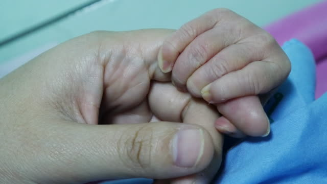 Baby newborn Holding Mother's Finger , 4k resolution (UHD) video