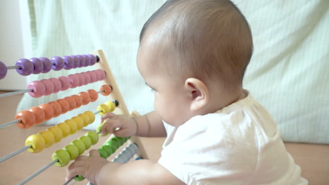 Baby playing colorful abacus toy Baby playing colorful abacus toy genius stock videos & royalty-free footage