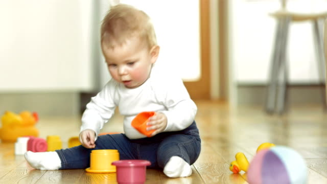 Baby Playing With Blocks On The Floor video