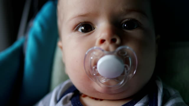 baby playing with toy, close up - ciuccio video stock e b–roll