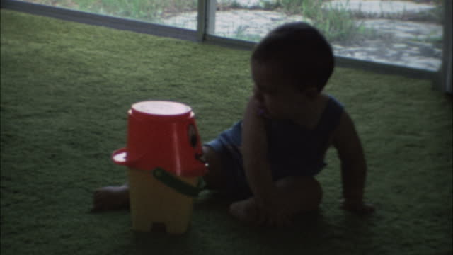 Baby plays with toy. video