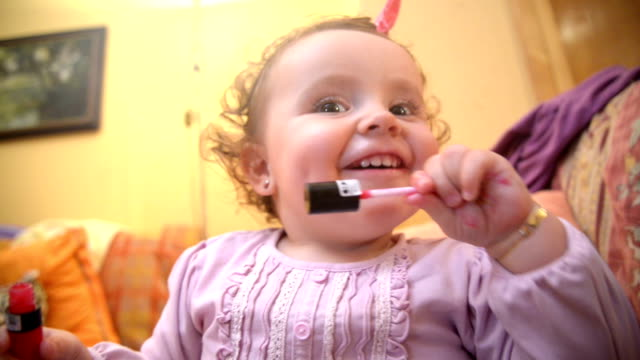 Baby putting on make up video