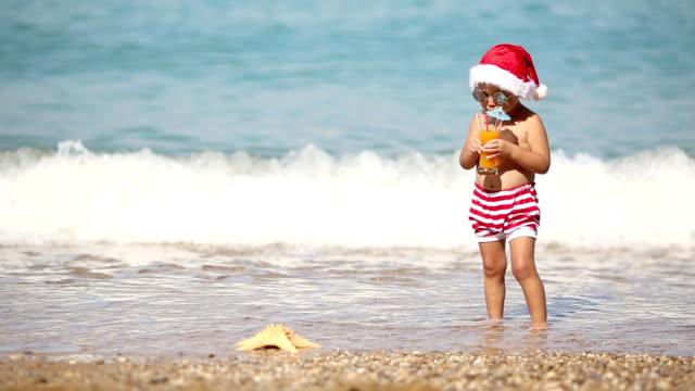 Baby Santa Claus at sea