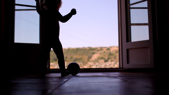 Baby silhouette standing in doorway video