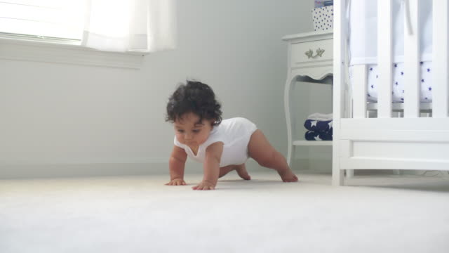 Baby Sitting Then Crawls Toward with Smile video