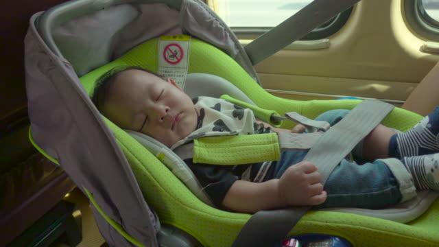 Baby Sleeping in car seat. video