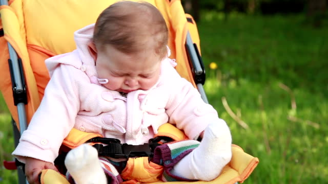 Baby sneezing in the park video