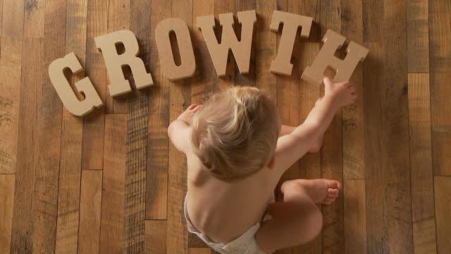 Baby spells 'Growth' video