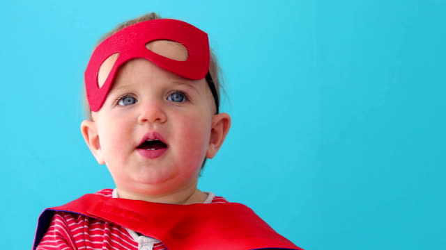 vídeos de stock e filmes b-roll de baby superhero looking away - baby super hero
