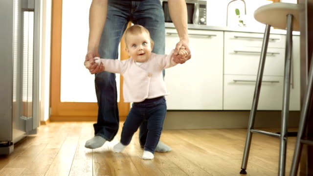 Baby Taking First Steps With Father's Help video