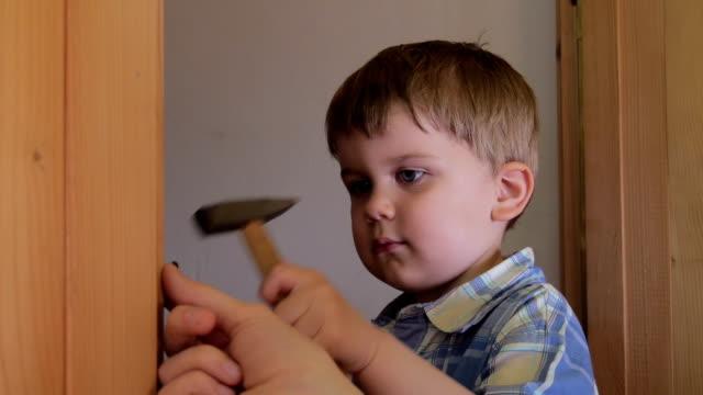 Baby using hammer video