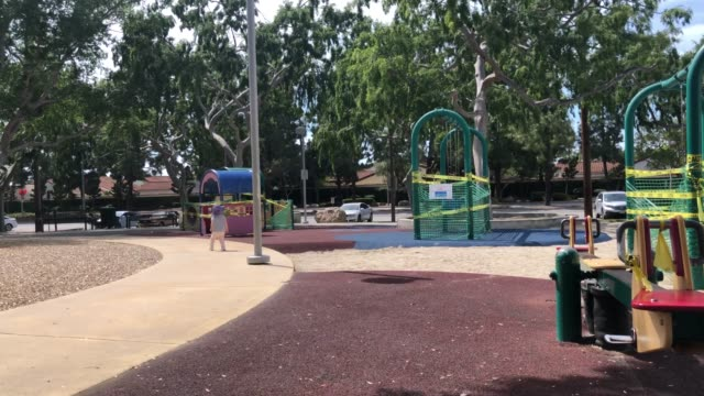 Baby walking around a closed playground during COVID-19 outbreak video