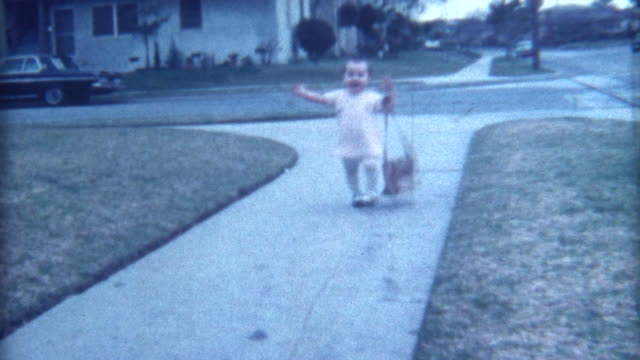 Baby With Purse Falling Down 1968