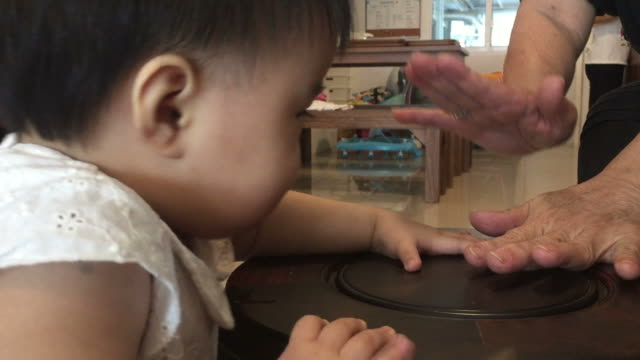 baby's hand and mother playing together - barile video stock e b–roll