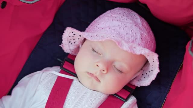vídeos de stock e filmes b-roll de baby's sleeping in the stroller - dormitar