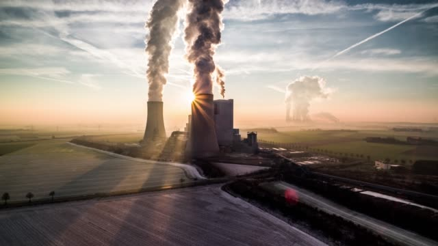back lit power station - aerial shot - smog video stock e b–roll