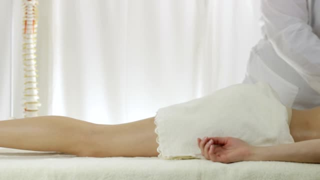 Back massage in a massage parlor, pan camera video