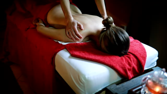 Back massage in spa centre Young woman enjoying spa treatment massage oil stock videos & royalty-free footage