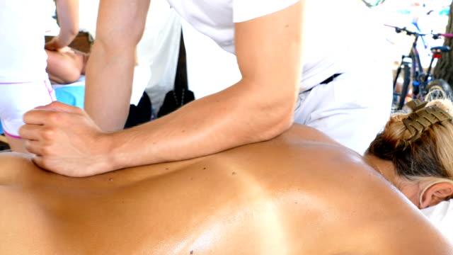 back massage - china drug video stock e b–roll