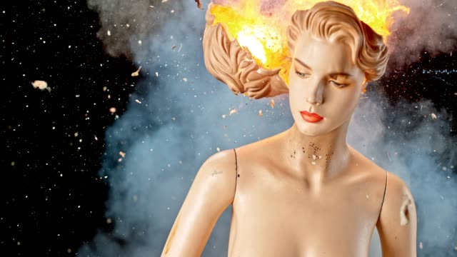 SLO MO LD Back of the head of a mannequin exploding and catching fire