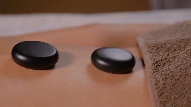 back of woman having hot stone massage at spa - china drug video stock e b–roll
