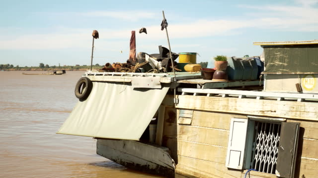 Back to a dredging boat in the foreground, another one sailing on Mekong river in the background Back to a dredging boat in the foreground, another one sailing on Mekong river in the background car transporter stock videos & royalty-free footage