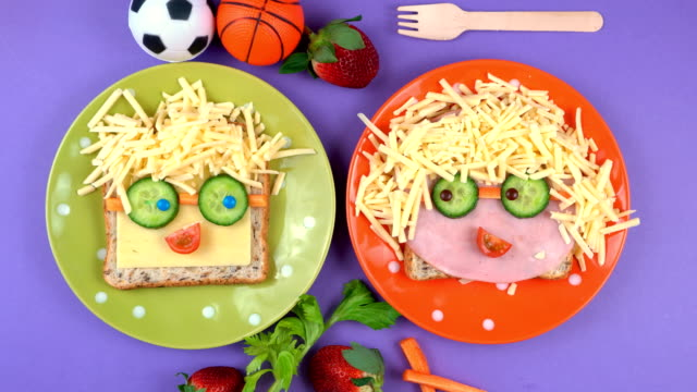 Back to school fun lunches concept, making children's faces sandwiches