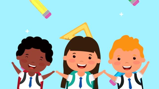 vídeos de stock e filmes b-roll de back to school season with interracial kids and supplies - setembro