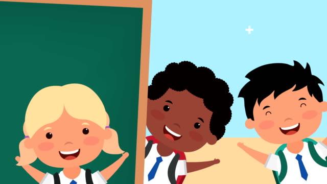 vídeos de stock e filmes b-roll de back to school season with interracial kids - setembro
