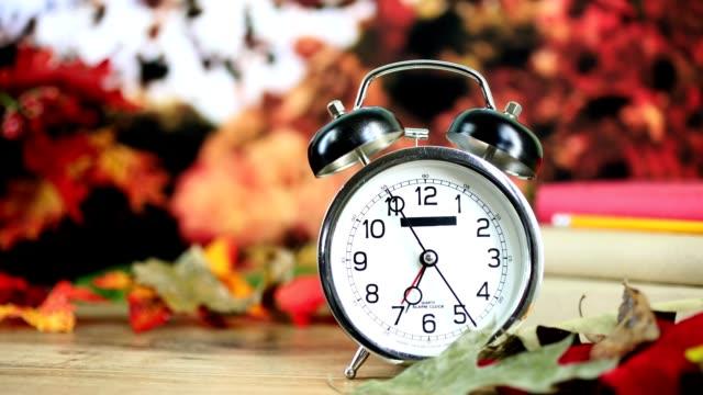 Back to school with alarm clock in autumn season. video