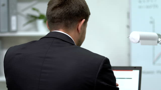 Back view of businessman touching painful shoulder, health problems, work Back view of businessman touching painful shoulder, health problems, work back to back stock videos & royalty-free footage