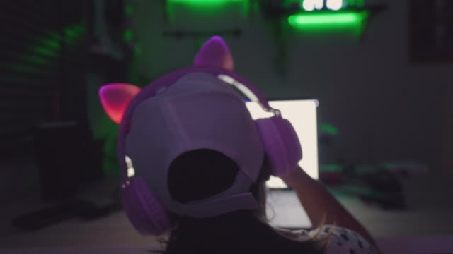 back view of girl dance while sitting - cuffie wireless video stock e b–roll
