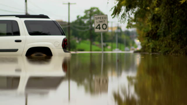 Backend White Car Stranded In Flood video