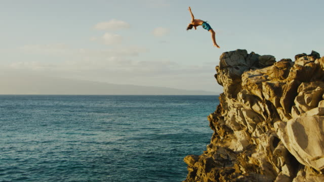 backflip cliff jumping into the ocean - cliffs stock videos & royalty-free footage
