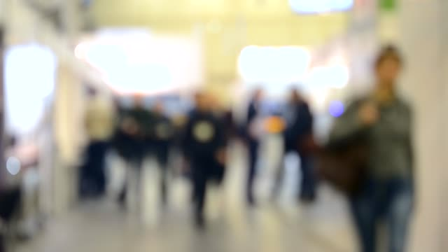 background blur people inside and walking in a shopping mall background blur people inside and walking in a shopping mall or center, expo exhibition stock videos & royalty-free footage