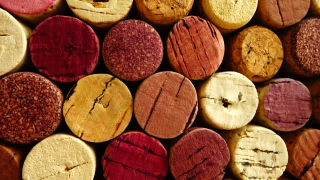 Background from wine corks. Shooting in motion. Background from wine corks. Shooting in motion. cork stopper stock videos & royalty-free footage