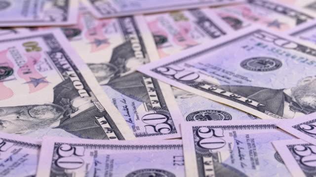 Background of American Banknotes Value of 50 Dollar Rotate video