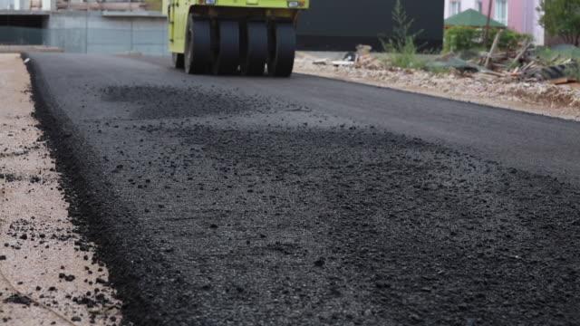 Background of asphalt roller that stack and press hot asphalt