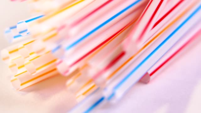 Background of Colored plastic straws, macro shot. Background of Colored plastic straws. Macro shot. Use of plastic straps is really bad for the ocean and has become a global environmental problem. straw stock videos & royalty-free footage