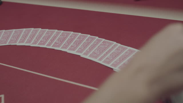 Background of laying out the pocker cards on table and turning them video