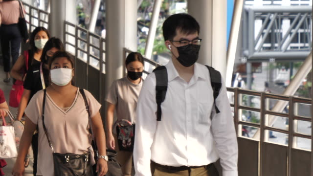 Background of People wears mask commuting to work Thailand,China - East Asia, Asia, Hong Kong, Mask - Disguise, Face Mask - Protective Workwear face mask videos stock videos & royalty-free footage