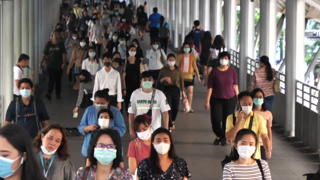 background of people wears mask in thailand - businessman covid mask video stock e b–roll